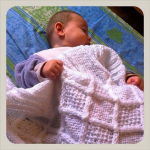 Menucha Chwat's granddaughter with homemade blanket