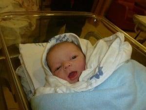baby boy in bassinette