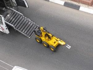 robot exiting van